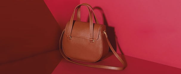 Стильні сумки, клатчі, рюкзаки за суперцінами