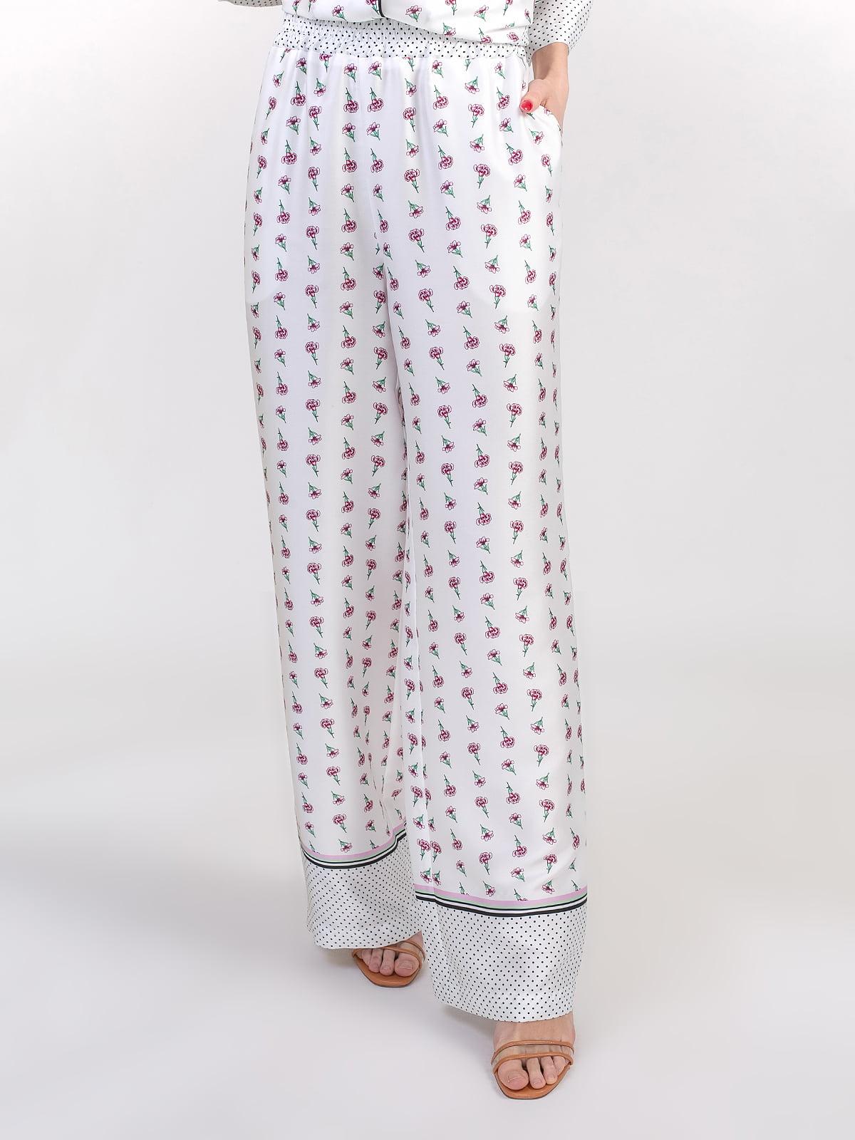 Штани білі в квітковий принт | 5352057