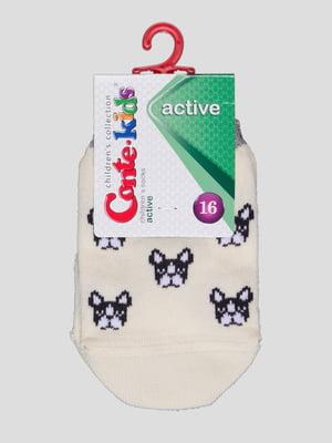 Шкарпетки кремового кольору з малюнком | 4366783