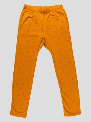 Штани помаранчеві в принт | 4506436