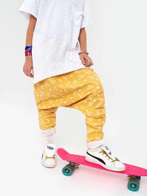 Штани жовті в принт | 4613407