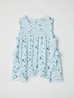 Блуза блакитна з квітковим принтом | 5012017