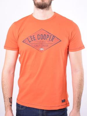 Футболка помаранчевого кольору з принтом | 5369679
