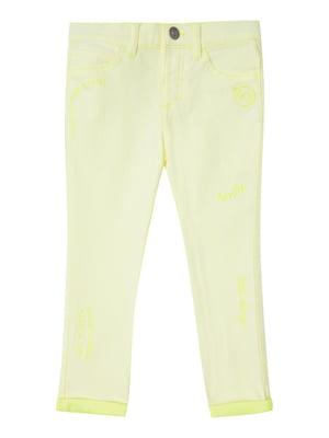Джинсы светло-желтые с принтом   5371367