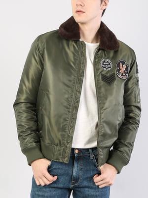 Куртка зеленая с нашивкой   5376690