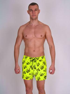 Шорты пляжные желтые с принтом | 5396778