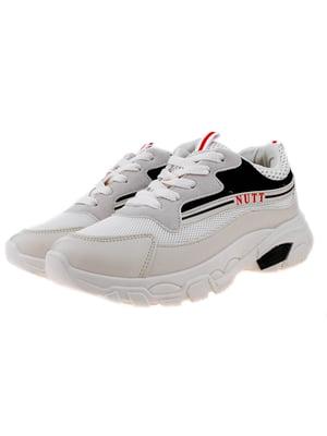 Кросівки чорно-бежевого кольору | 5321894