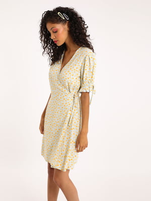 Сукня молочного кольору в принт   5488132