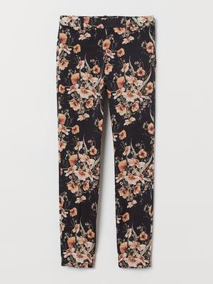 Штани чорні в квітковий принт | 5501932