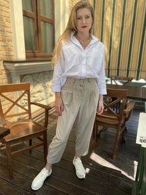 Штани біло-бежевого кольору в смужку | 5516138