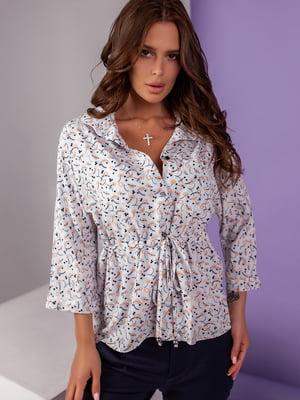 Блуза блакитна з принтом | 5527573