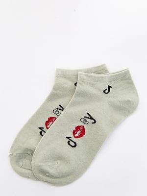 Шкарпетки оливкового кольору з малюнком   5530572