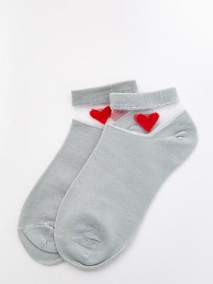 Шкарпетки оливкового кольору з декором   5530594