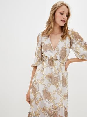 Сукня бежева в комбінований принт | 5542476