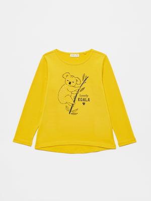 Лонгслив желтый с принтом | 5583079