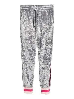 Штани спортивні сріблястого кольору в принт | 5608798