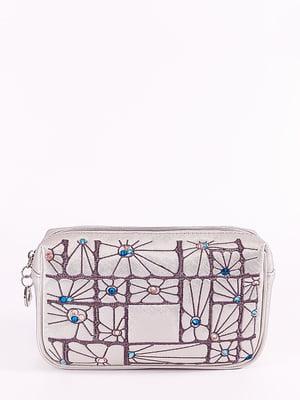 Косметичка серебристого цвета с декором | 5636642