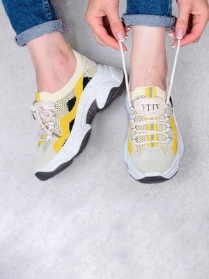 Кросівки бежевого кольору | 5644352