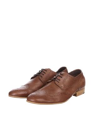 Дербі коричневого кольору | 5694556