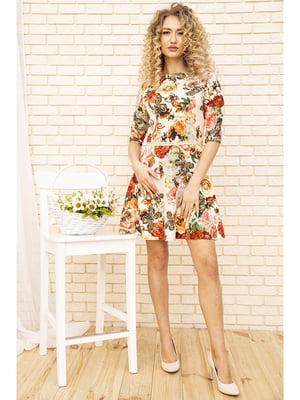 Платье бежевого цвета с цветочным принтом | 5703918