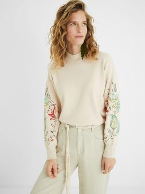 Джемпер бежевого кольору з квітковим принтом | 5710356