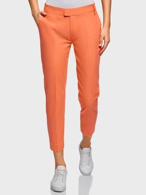 Штани помаранчевого кольору | 5720884