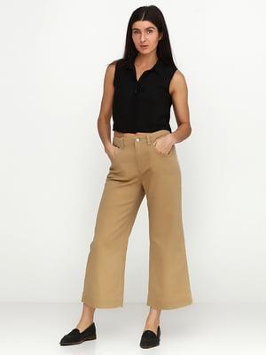 Штани коричневого кольору | 5729614