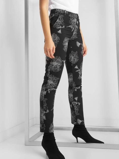 Штани чорні в квітковий принт Orsay 4876409