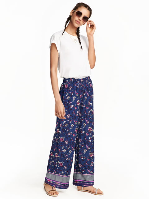 Брюки синие в цветочный принт H&M 5045075