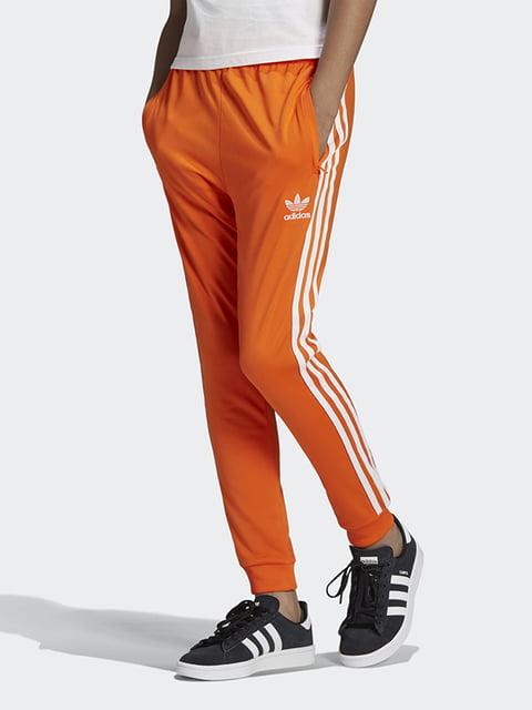 Штани спортивні помаранчевого кольору Adidas 5120110